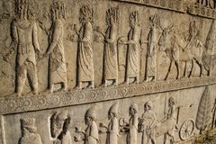Persepolis is the capital of the Achaemenid kingdom. sight of Iran. Ancient Persia. Bas-relief on the walls of old buildings. Walls of the ancient capital of stock photography