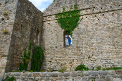 The walls of the ancient fortress in Old Bar, Montenegro. Young woman stands in the aperture of the wall of ancient fortress in the Old Bar, Montenegro Stock Photography