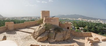 Free Walls And Turrets Of The Fort Of Nahkal And The Village With The Mosque In The Background Royalty Free Stock Images - 139500109
