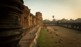 Walls of Angkor. Inner walls of Angkor with person for perspective. Sunrise colorfull colors Royalty Free Stock Photos