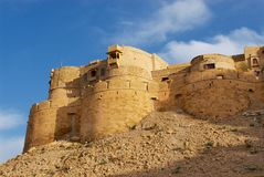Walls and bastions of the fort with the blue sky above in Jaisalmer, India. royalty free stock images