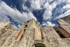 Walls of Celje castle, Slovenia. Defensive wall and palace in castle Celje with cloudy background, Slovenia Royalty Free Stock Photo
