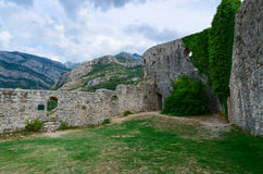 The walls of citadel overlooking mountains, Old Bar, Montenegro Stock Images