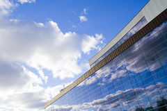 Walls and clouds reflections 1. Clouded sky reflected into glassy wall of administrative building royalty free stock photos