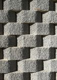 Walls with concrete stone blocks. In geometric position playing with shadow royalty free stock photo