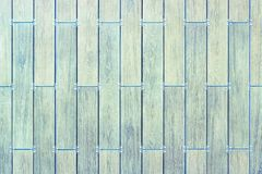 Walls and construction tiles. The texture of the tiles. The colors of ceramic tiles with a touch of wood royalty free stock image