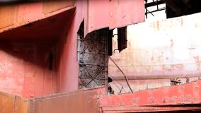 Walls Are Almost Destroyed Factory. Rusted and ruined factory Moving camera stock footage