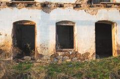 Walls and facade of abandoned building. Walls and facade of an old ruined abandoned building royalty free stock photo