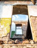 Walls and facade of an ruined abandoned building. Walls and facade of an old ruined abandoned building royalty free stock photography