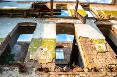 Walls and facade of an ruined abandoned building. Walls and facade of an old ruined abandoned building stock image