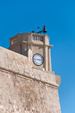 The walls of the fortress of Victoria, Rabat, with the clock, Go Royalty Free Stock Photo