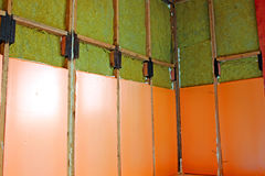 Walls of a frame house with different types of heat insulation. Construction of walls of a frame house with different types of heat insulation royalty free stock photos
