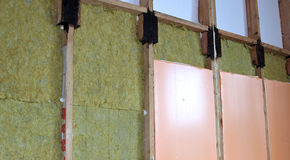 Walls of a frame house with different types of heat insulation. Construction of walls of a frame house with different types of heat insulation stock photography