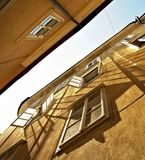 Walls full of windows. Open windows during summer time in the traditional alley Royalty Free Stock Images