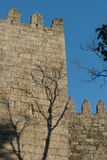 Walls of Guimaraes, Northern Portugal. Walls of Guimaraes, a late romanesque/early gothic tenth century fortification built on the foundations of a Roman royalty free stock images