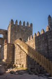 Walls of Guimaraes, Northern Portugal. Walls of Guimaraes, a late romanesque/early gothic tenth century fortification built on the foundations of a Roman stock photos