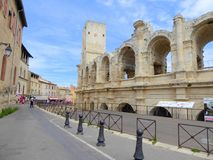 Walls of historic Roman amphitheatre. The stone walls of the Roman amphitheatre in the city of Arles in Provence in France Royalty Free Stock Image