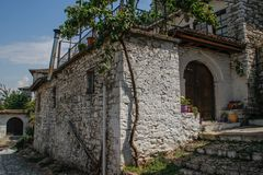 The walls, house and stone road in the historic white town below the fortress stock photography