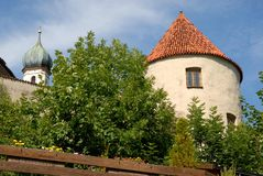 Walls with large circular tower of the town of Fussen in Bavaria (Germany) Stock Photos