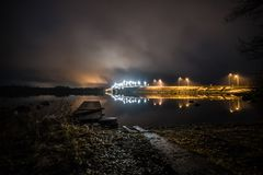 Walls With Lights Near Calm Body of Water at Night Time Royalty Free Stock Images