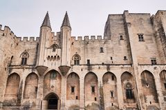 Walls of the medieval Castle of the Popes. In the city of Avignon in France Royalty Free Stock Photography