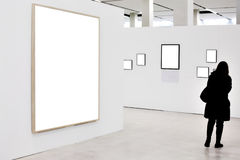 Walls in museum with empty frames and person Royalty Free Stock Images