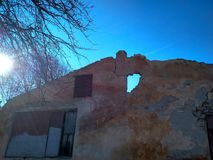 View on ruined old big house or building and blue sky in background stock photo