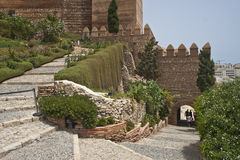 Walls of an old fortress Alcazaba Stock Images