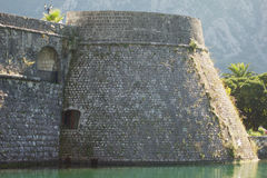 The walls of the old fortress. Near the old fortress dug a channel for water Royalty Free Stock Photo