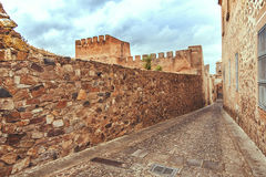The walls of old medieval city Caceres Stock Photos