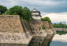 Walls of Osaka Castle with water reflections Royalty Free Stock Images