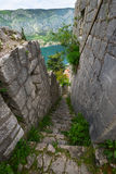 The walls of the Palace in Fortress of Kotor. The stone wall of the palace in the fortress of Kotor, Montenegro, with sight of Kotor Bay Royalty Free Stock Photo