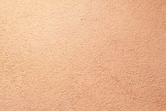 Walls. plaster applied to it. composition of small stones. and in a special way pounded. frame location. light peach color.  royalty free stock images