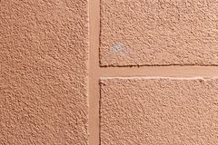 Walls. plaster applied to it. composition of small stones. and in a special way pounded. frame location. peach colour. in the. Center there are lanes which cuts stock images