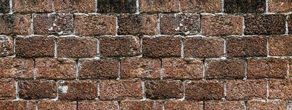 Brick wall red-brown volcanic background stock photo