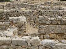 Walls and spaces of historic Greek houses. Excavation of the former historic city of Empúries (Latin: Emporium), inhabited by the ancients Greeks and Romans ( Stock Photography