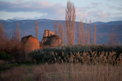 Walls at sunset. Towers of the theater gate of the ancient roman city walls of iznik (nicea), Turkey royalty free stock images