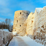 Walls and tower of mediaval fortress. Tower Temnushka and the main entrance to the Izborsk fortress stock photography