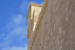 Walls with tower of Victoria. Massive defensive stone walls of Victoria (Ir-Rabat Għawdex) on Gozo Island, in the background blue sky Royalty Free Stock Photo