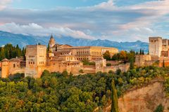 Granada. The fortress and palace complex Alhambra. Walls and towers of the fortress of the Alhambra at sunset in Granada. Andalusia. Spain royalty free stock photos
