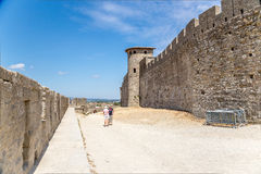 Walls and towers of the fortress of Carcassonne, France. The Cite de Carcassonne is a medieval citadel located in the French city of Carcassonne, in the Royalty Free Stock Images