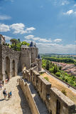 Walls and towers of the medieval fortress in Carcassonne, France. The Cite de Carcassonne is a medieval citadel located in the French city of Carcassonne, in the Stock Photos