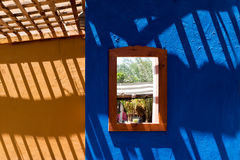 Walls in vibrant colors. Walls painted with vibrant summer color and long shadows casting on from high Stock Photo