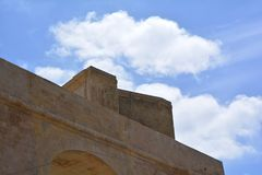 Walls of Victoria. Massive defensive stone walls of Victoria (Ir-Rabat Għawdex) on Gozo Island, in the background blue sky with clouds Royalty Free Stock Images