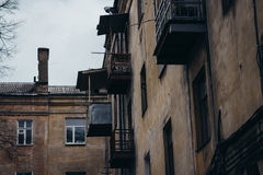 The walls and Windows of the old residential apartment house Royalty Free Stock Images