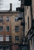 The walls and Windows of the old residential apartment house Royalty Free Stock Photo