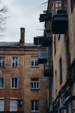 The walls and Windows of the old residential apartment house Stock Photography
