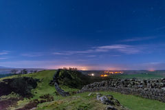 Walltown Crags on Hadrians Wall at night. Moonlit Hadrians Wall is in the recently awarded Dark Sky Park in Northumberland Royalty Free Stock Images