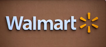 Walmart. The new Walmart sign on a brown wall Royalty Free Stock Images