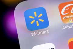 Walmart application icon on Apple iPhone X screen close-up. Walmart app icon. Walmart.com is multinational retailing corporation. Sankt-Petersburg, Russia, March Stock Images